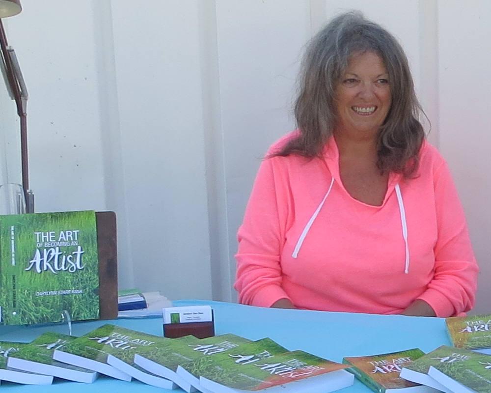 Darylynn selling her book